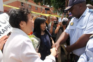 Victim's wife shakes hand of Cleveland Station Commander after he signs memorandum